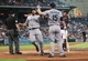 Jul 21, 2013; Houston, TX, USA; Seattle Mariners left fielder Raul Ibanez (28) is congratulated by Kyle Seager (15) after scoring a run during the fifth inning against the Houston Astros at Minute Maid Park. Mandatory Credit: Troy Taormina-USA TODAY Sports