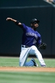 Jul 21, 2013; Denver, CO, USA; Colorado Rockies second baseman Jonathan Herrera (18) fields a ground ball during the first inning against the Chicago Cubs  at Coors Field. Mandatory Credit: Chris Humphreys-USA TODAY Sports
