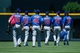 Jul 21, 2013; Denver, CO, USA; Members of the Chicago Cubs pitching staff walk through the outfield before the first inning against the Colorado Rockies at Coors Field. Mandatory Credit: Chris Humphreys-USA TODAY Sports