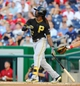 Jul 22, 2013; Washington, DC, USA; Pittsburgh Pirates center fielder Andrew McCutchen (22) hits a two run homer during the first inning against the Washington Nationals at Nationals Park.  Mandatory Credit: Brad Mills-USA TODAY Sports