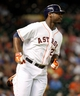 Jul 22, 2013; Houston, TX, USA; Houston Astros first baseman Chris Carter (23) runs to first base after hitting a single during the third inning against the Oakland Athletics at Minute Maid Park. Mandatory Credit: Troy Taormina-USA TODAY Sports