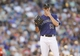 Jul 22, 2013; Denver, CO, USA; Colorado Rockies pitcher Drew Pomeranz (13) reacts during the third inning against the Miami Marlins at Coors Field.Mandatory Credit: Chris Humphreys-USA TODAY Sports