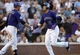 Jul 22, 2013; Denver, CO, USA; Colorado Rockies shortstop Troy Tulowitzki (2) is greeted by right fielder Michael Cuddyer (3) after hitting a solo home run during the fourth inning against the Miami Marlins at Coors Field. Mandatory Credit: Chris Humphreys-USA TODAY Sports