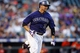 Jul 22, 2013; Denver, CO, USA; Colorado Rockies right fielder Michael Cuddyer (3) runs to first base on a double during the fourth inning against the Miami Marlins at Coors Field. Mandatory Credit: Chris Humphreys-USA TODAY Sports