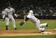 Jul 22, 2013; Chicago, IL, USA; Detroit Tigers catcher Brayan Pena (55) is safe at third base as Chicago White Sox third baseman Conor Gillaspie (12) cannot catch an errant throw during the ninth inning at U.S. Cellular Field. Mandatory Credit: David Banks-USA TODAY Sports