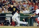 Jul 22, 2013; Washington, DC, USA; Pittsburgh Pirates second baseman Jordy Mercer (10) singles during the seventh inning against the Washington Nationals at Nationals Park.  Mandatory Credit: Brad Mills-USA TODAY Sports