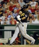 Jul 22, 2013; Washington, DC, USA; Pittsburgh Pirates first baseman Pedro Alvarez (24) singles during the eighth inning against the Washington Nationals at Nationals Park.  Mandatory Credit: Brad Mills-USA TODAY Sports