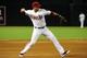 Jul 22, 2013; Phoenix, AZ, USA; Arizona Diamondbacks third baseman Martin Prado (14) throws to first base during the fourth inning against the Chicago Cubs at Chase Field. Mandatory Credit: Matt Kartozian-USA TODAY Sports
