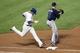 Jul 22, 2013; New York, NY, USA;  Atlanta Braves first baseman Freddie Freeman (5) has New York Mets center fielder Juan Lagares (12) out during the seventh inning at Citi Field.  Atlanta Braves won 2-1.  Credit: Anthony Gruppuso-USA TODAY Sports