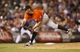 Jul 22, 2013; Denver, CO, USA; Miami Marlins pitcher Steve Cishek (31) delivers a pitch during the eighth inning against the Colorado Rockies at Coors Field. The Marlins won 3-1. Mandatory Credit: Chris Humphreys-USA TODAY Sports