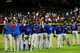 Jul 22, 2013; Phoenix, AZ, USA;  Members of the Chicago Cubs celebrate after beating the Arizona Diamondbacks 4-3 at Chase Field. Mandatory Credit: Matt Kartozian-USA TODAY Sports