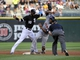 Jul 23, 2013; Chicago, IL, USA; Chicago White Sox shortstop Alexei Ramirez (10) tags out Detroit Tigers center fielder Austin Jackson (14) on a steal attempt during the first inning at U.S Cellular Field. Mandatory Credit: David Banks-USA TODAY Sports