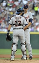 Jul 23, 2013; Chicago, IL, USA; Detroit Tigers catcher Alex Avila (13) talks with starting pitcher Rick Porcello (21) during the first inning in a game against the Chicago White Sox at U.S Cellular Field. Mandatory Credit: David Banks-USA TODAY Sports