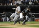 Jul 23, 2013; Chicago, IL, USA; Detroit Tigers shortstop Jhonny Peralta (27) scores as Chicago White Sox catcher Josh Phegley (36) takes the throw during the fourth inning at U.S Cellular Field. Mandatory Credit: David Banks-USA TODAY Sports