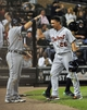 Jul 23, 2013; Chicago, IL, USA; Detroit Tigers shortstop Hernan Perez (26) is greeted by catcher Alex Avila (13) after hitting an RBI triple and scoring on an error against the Chicago White Sox during the sixth inning  at U.S Cellular Field. Mandatory Credit: David Banks-USA TODAY Sports