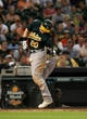 Jul 23, 2013; Houston, TX, USA; Oakland Athletics third baseman Josh Donaldson (20) is hit by a pitch during the eighth inning against the Houston Astros at Minute Maid Park. Mandatory Credit: Troy Taormina-USA TODAY Sports