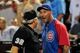 Jul 23, 2013; Phoenix, AZ, USA; Chicago Cubs manager Dale Sveum (4) argues with umpire Dana DeMuth during the third inning against the Arizona Diamondbacks at Chase Field. Mandatory Credit: Matt Kartozian-USA TODAY Sports