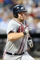 Jul 24, 2013; New York, NY, USA;  Atlanta Braves catcher Brian McCann (16) reaches on an error during the fifth inning against the New York Mets at Citi Field Mandatory Credit: Anthony Gruppuso-USA TODAY Sports