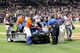 Jul 24, 2013; New York, NY, USA;  Atlanta Braves starting pitcher Tim Hudson (15) is taken off the field on a cart after being injured in collision at first base with New York Mets left fielder Eric Young Jr. (not pictured) during the eighth inning at Citi Field. Mandatory Credit: Anthony Gruppuso-USA TODAY Sports