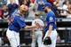 Jul 25, 2013; New York, NY, USA;   New York Mets catcher John Buck (44) and relief pitcher Bobby Parnell (39) celebrate the win against the Atlanta Braves at Citi Field. Mets won 7-4.  Mandatory Credit: Anthony Gruppuso-USA TODAY Sports