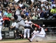 Jul 25, 2013; Chicago, IL, USA; Chicago White Sox catcher Tyler Flowers (21) slides safely into home plate as Detroit Tigers catcher Brayan Pena (55) takes a high throw during the fourth inning at U.S. Cellular Field. Mandatory Credit: David Banks-USA TODAY Sports