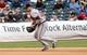 Jul 25, 2013; New York, NY, USA;  Atlanta Braves third baseman Chris Johnson (23) bobbles the ball during the eighth inning against the New York Mets at Citi Field. Mets won 7-4.  Mandatory Credit: Anthony Gruppuso-USA TODAY Sports