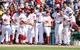Jul 25, 2013; Washington, DC, USA; Washington Nationals players wait for Bryce Harper (not shown) to round the bases after a walk-off two run homer during the ninth inning against the Pittsburgh Pirates at Nationals Park. Mandatory Credit: Brad Mills-USA TODAY Sports