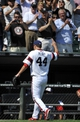 Jul 25, 2013; Chicago, IL, USA;  Chicago White Sox starting pitcher Jake Peavy (44) is cheered by fans after leaving the game during the eighth inning in a game against the Detroit Tigers at U.S. Cellular Field. The Chicago White Sox defeated the Detroit Tigers 7-4. Mandatory Credit: David Banks-USA TODAY Sports