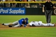 Jul 25, 2013; Phoenix, AZ, USA; Chicago Cubs shortstop Starlin Castro (13)  lands on top of Arizona Diamondbacks third baseman Martin Prado (14) while sliding during the fifth inning at Chase Field. Mandatory Credit: Matt Kartozian-USA TODAY Sports