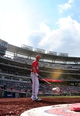 Jul 26, 2013; Washington, DC, USA; Washington Nationals outfielder Bryce Harper (34) tosses the bat weight during the game against the New York Mets at Nationals Park. Mandatory Credit: Evan Habeeb-USA TODAY Sports