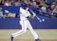 Jul 26, 2013; Toronto, Ontario, CAN; Toronto Blue Jays designated hitter Edwin Encarnacion (10) hits a grand slam home run in the seventh inning against the Houston Astros at the Rogers Centre. Mandatory Credit: John E. Sokolowski-USA TODAY Sports