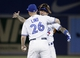 Jul 26, 2013; Toronto, Ontario, CAN; Toronto Blue Jays designated hitter Adam Lind (26) and third baseman Brett Lawrie (13) embrace after a win over the Houston Astros at the Rogers Centre. Toronto defeated Houston 12-6. Mandatory Credit: John E. Sokolowski-USA TODAY Sports
