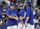 Jul 26, 2013; Toronto, Ontario, CAN; Toronto Blue Jays manager John Gibbons congratulates starting pitcher R.A. Dickey (43) after a win over the Houston Astros at the Rogers Centre. Toronto defeated Houston 12-6. Mandatory Credit: John E. Sokolowski-USA TODAY Sports
