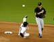 Jul 27, 2013; Miami, FL, USA;  Pittsburgh Pirates shortstop Clint Barmes (12) completes a double play getting the force out on Miami Marlins shortstop Adeiny Hechavarria (3) in the ninth inning at Marlins Park. The Pirates won 7-4. Mandatory Credit: Robert Mayer-USA TODAY Sports