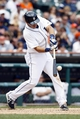 Jul 28, 2013; Detroit, MI, USA; Detroit Tigers shortstop Hernan Perez (26) hits an RBI single in the seventh inning against the Philadelphia Phillies at Comerica Park. Mandatory Credit: Rick Osentoski-USA TODAY Sports