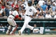 Jul 28, 2013; Detroit, MI, USA; Detroit Tigers center fielder Austin Jackson (14) scores a run as Philadelphia Phillies catcher Carlos Ruiz (51) wait on the throw in the seventh inning at Comerica Park. Mandatory Credit: Rick Osentoski-USA TODAY Sports