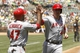 Jul 28, 2013; Oakland, CA, USA; Los Angeles Angels infielder Mark Trumbo (44) is congratulated by infielder Howie Kendrick (47) after scoring a run against the Oakland Athletics in the first inning at O.co Coliseum. Mandatory Credit: Cary Edmondson-USA TODAY Sports