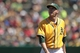 Jul 28, 2013; Oakland, CA, USA; Oakland Athletics pitcher Jarrod Parker (11) walks towards the dugout after being pulled from the game against the Los Angeles Angels in the sixth inning at O.co Coliseum. Mandatory Credit: Cary Edmondson-USA TODAY Sports