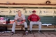 Jul 28, 2013; Oakland, CA, USA; Los Angeles Angels outfielder Mike Trout (27) sits next to manager Mike Scioscia (14) before the start of the game against the Oakland Athletics at O.co Coliseum. The Athletics defeated the Angels 10-6. Mandatory Credit: Cary Edmondson-USA TODAY Sports