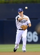 Jul 29, 2013; San Diego, CA, USA; San Diego Padres second baseman Logan Forsythe (11) throws to first base for an out during the first inning against the Cincinnati Reds at Petco Park. . Mandatory Credit: Christopher Hanewinckel-USA TODAY Sports
