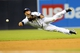 Jul 30, 2013; San Diego, CA, USA; San Diego Padres shortstop Everth Cabrera (2) tries to get a runner at third base with a diving throw during the second inning against the Cincinnati Reds at Petco Park. Mandatory Credit: Christopher Hanewinckel-USA TODAY Sports