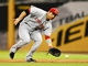 Jul 30, 2013; San Diego, CA, USA; Cincinnati Reds first baseman Joey Votto (19) fields a ground ball during the third inning against the San Diego Padres at Petco Park. Mandatory Credit: Christopher Hanewinckel-USA TODAY Sports