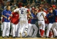 Jul 30, 2013; Arlington, TX, USA; Texas Rangers left fielder Leonys Martin (2) celebrates with teammates after hitting a walk off home run to beat the Los Angeles Angels in the tenth inning at Rangers Ballpark in Arlington . Mandatory Credit: Kevin Jairaj-USA TODAY Sports