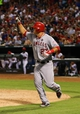 Jul 30, 2013; Arlington, TX, USA; Los Angeles Angels center fielder Mike Trout (27) celebrates after scoring  during the game against the Texas Rangers at Rangers Ballpark in Arlington. Mandatory Credit: Kevin Jairaj-USA TODAY Sports