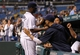 Jul 30, 2013; St. Petersburg, FL, USA; Tampa Bay Rays starting pitcher Roberto Hernandez (40) is congratulated by teammates after pitching against the Arizona Diamondbacks at Tropicana Field. Tampa Bay Rays defeated the Arizona Diamondbacks 5-2. Mandatory Credit: Kim Klement-USA TODAY Sports