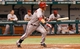Jul 30, 2013; St. Petersburg, FL, USA; Arizona Diamondbacks shortstop Cliff Pennington (4) singles during the sixth inning against the Tampa Bay Rays at Tropicana Field. Mandatory Credit: Kim Klement-USA TODAY Sports