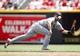 Aug 4, 2013; Cincinnati, OH, USA; St. Louis Cardinals second baseman Matt Carpenter (13) fields a ball during the second inning against the Cincinnati Reds at Great American Ball Park. Mandatory Credit: Frank Victores-USA TODAY Sports