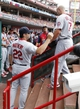 Aug 4, 2013; Cincinnati, OH, USA; St. Louis Cardinals left fielder Matt Holliday (7) is congratulated by manager Mike Matheny (22)  after scoring during the first inning against the Cincinnati Reds at Great American Ball Park. Mandatory Credit: Frank Victores-USA TODAY Sports