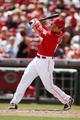 Aug 4, 2013; Cincinnati, OH, USA; Cincinnati Reds first baseman Joey Votto (19) doubles during the seventh inning against the St. Louis Cardinals at Great American Ball Park. The Cardinals defeated the Reds 15-2. Mandatory Credit: Frank Victores-USA TODAY Sports