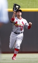 Aug 4, 2013; Cincinnati, OH, USA; St. Louis Cardinals center fielder Jon Jay (19) fields a ball during the eighth inning against the Cincinnati Reds at Great American Ball Park. The Cardinals defeated the Reds 15-2. Mandatory Credit: Frank Victores-USA TODAY Sports